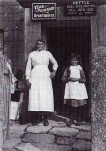 Emma Nottle outside her shop with her foster daughter, Joyce Hambly
