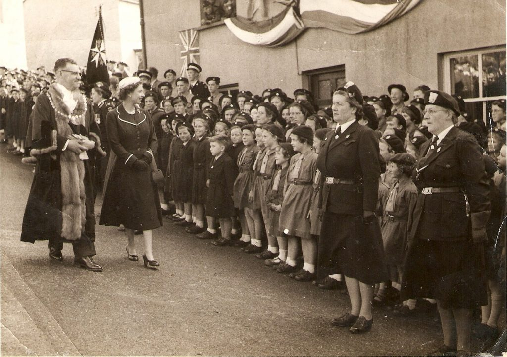 The Queen on her 1956 visit to Launceston greeting the Brownie's.