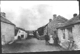 Jack Earle with his hoop along with Miss Dennis, Les Rundle and Olive Budge at Trebullett in 1919.