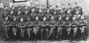 Above Launceston Homeguard in 1945. Back row, extreme right, W.S. Cottle. Middle row, 5th from left, W.H.(Bill) Jones, agricultural engineer and blacksmith. Front row, 5th from right, W.T.(Bill) Gynn, postman and part-time farmer. Photo courtesy of Chris Gynn.