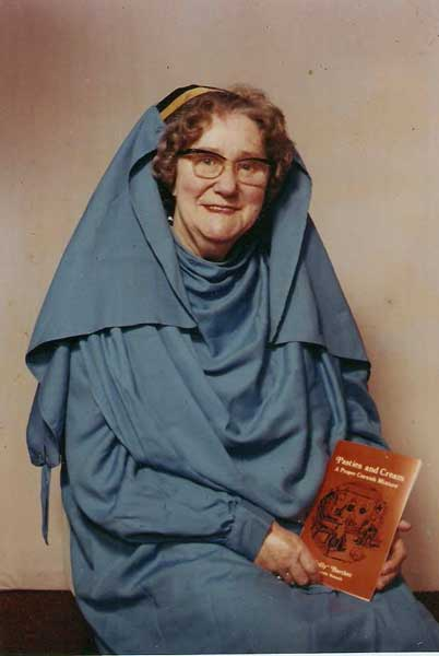 millicent-bartlett-in-her-robe-holding-one-of-her-books-pasties-and-cream
