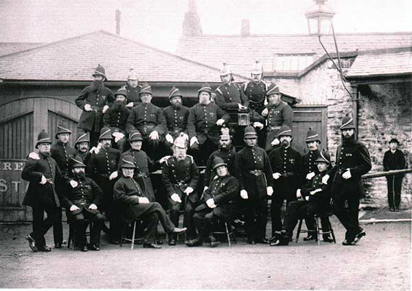 Launceston Volunteer Fire Brigade posing outside their Station in Market Street.