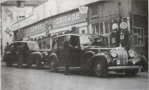Above Percy Spry greets the Queen and Prince Charles on their 1953 visit when they stopped at the Exeter Street Garage.