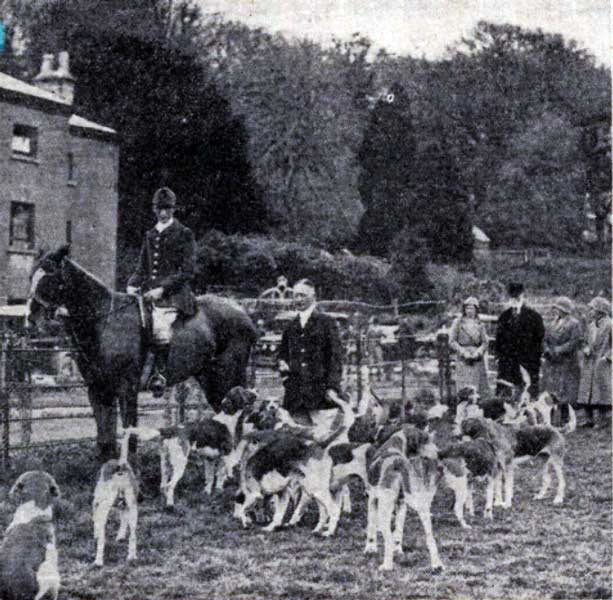 Major E. Rodd with the Huntsman of the East Cornwall Hunt in 1933 at his residence of Trebartha Hall which part of can be seen.