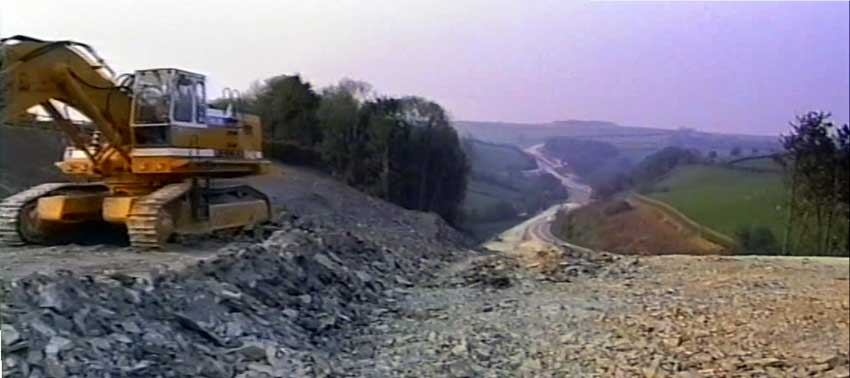 Above looking down towards Two Bridges in 1989 with the new A30 being cut through part of Strayer Park, Trevell.