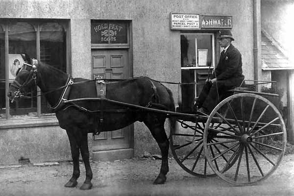 Horse drawn postman and trap at Ashwater post office c.1914.