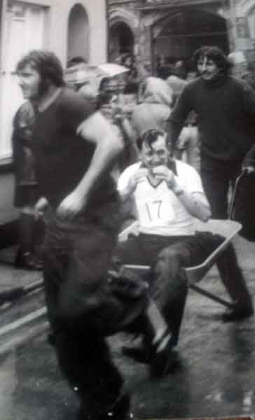 gerald-smith-being-pushed-in-a-wheelbarrow-race-by-ray-roberts