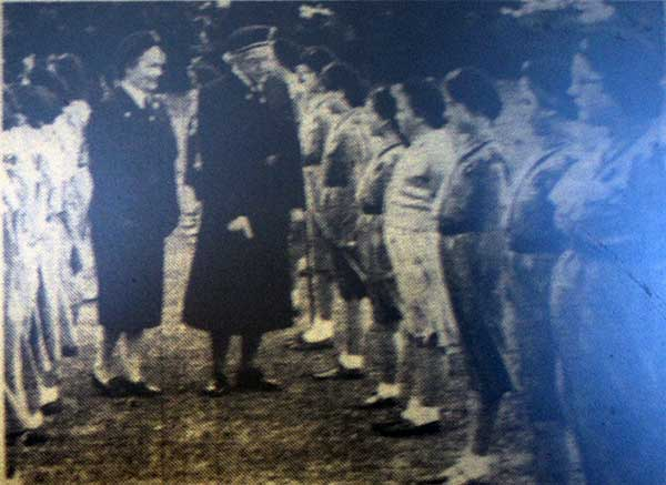 girl-guides-being-inspected-at-coronation-park-by-lady-moleswort-st-aubyn-the-district-commissionaire-in-1959