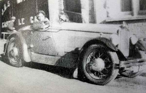miss-godbeer-of-j-b-smith-in-a-wolseley-sports-car
