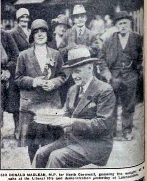 sir-donald-mclean-guessing-the-weight-of-a-cake-in-august-1930