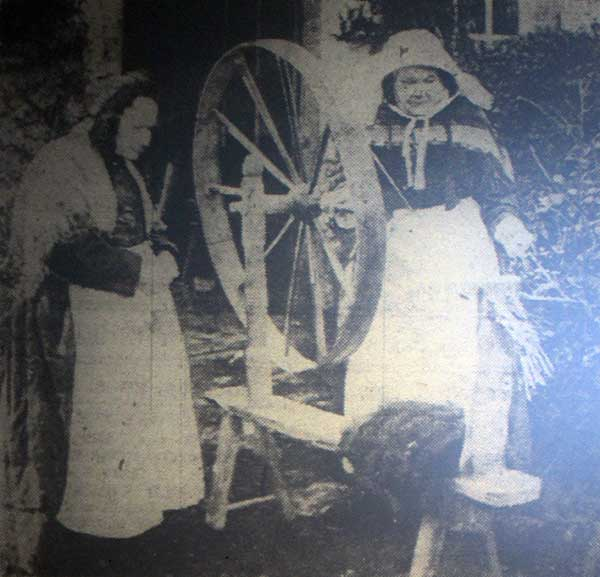 Mary Pearce and Mary Popplestone at Treween Cottage, Altarnun working their spinning wheel.
