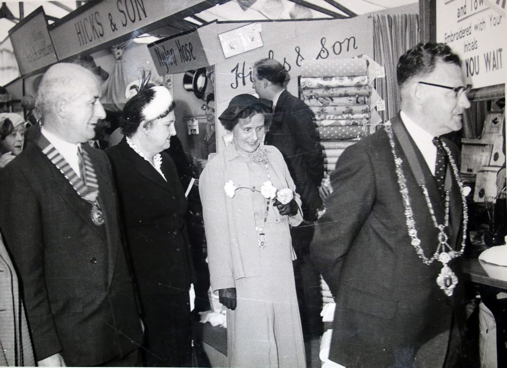 Cecil Robins and delegates tour the Launceston trades tent at the 1955 Bath and West Show