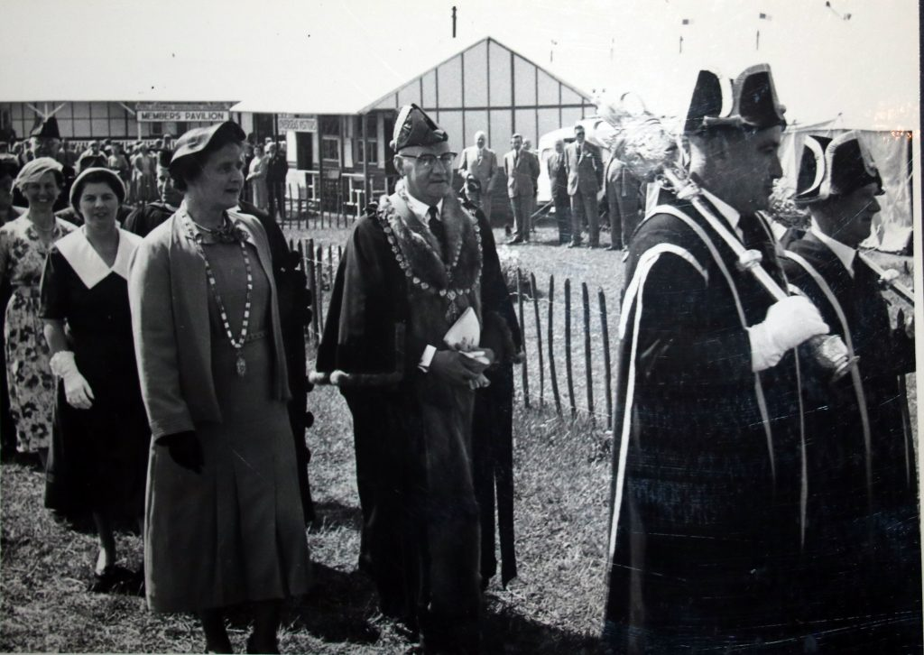 Cecil Robins is led to the opening speech at the 1955 Bath and West Show