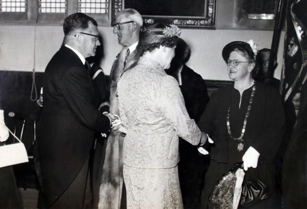 Cecil Robins congratulates the new mayor 1956