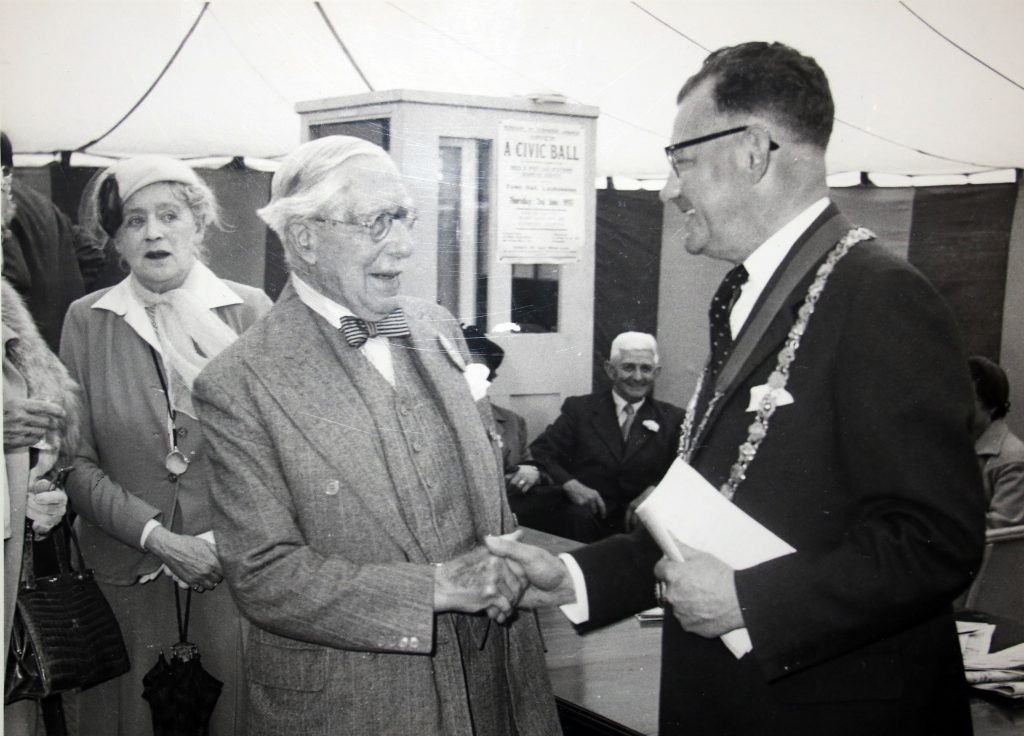 Cecil Robins greets a delegate at the 1955 Bath and West Show