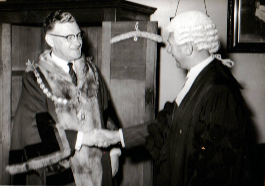 Newly chosen mayor Cecil Robins and the town clerk C. W. Parsons in the May of 1955