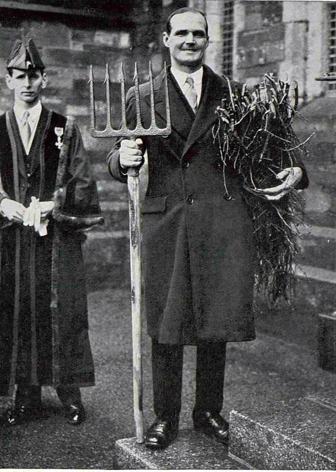 Mr. Stanley Langford with the Salmon spear and one carriage of wood to present to King George as representative of the manor of Stoke Climsland 1937.