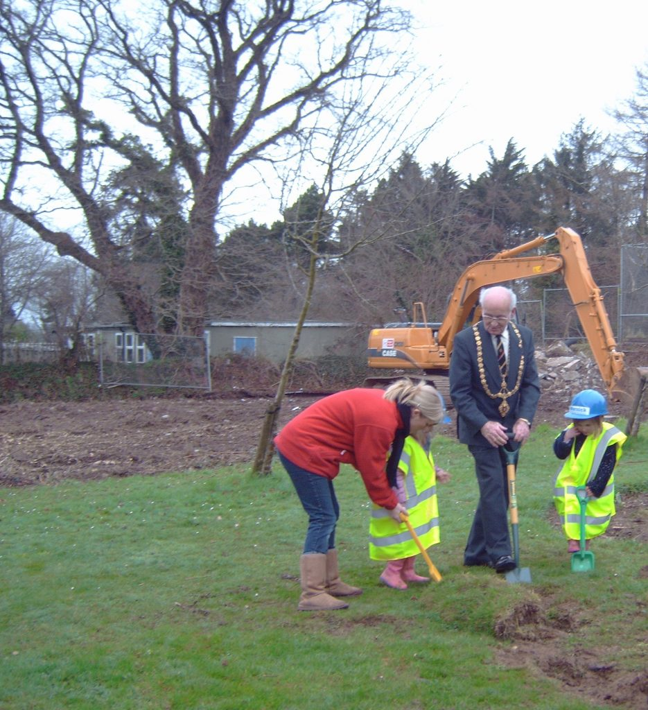 Mayor Eric Chapman cuts the first sod on the new childrens centre at Coronation Park