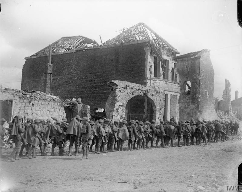 Troops of the 10th (Service) Battalion, Royal Fusiliers halted in Arras before going into action, 9 April 1917. Imperial War Museum image Q5112