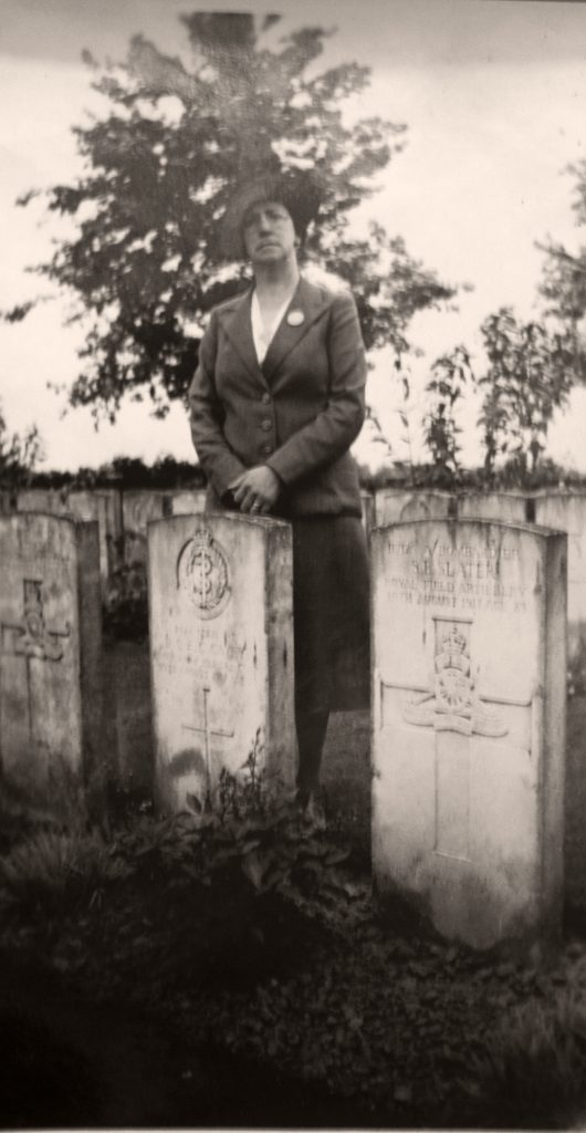 Gertrude Cavey photographed by her husbands grave.