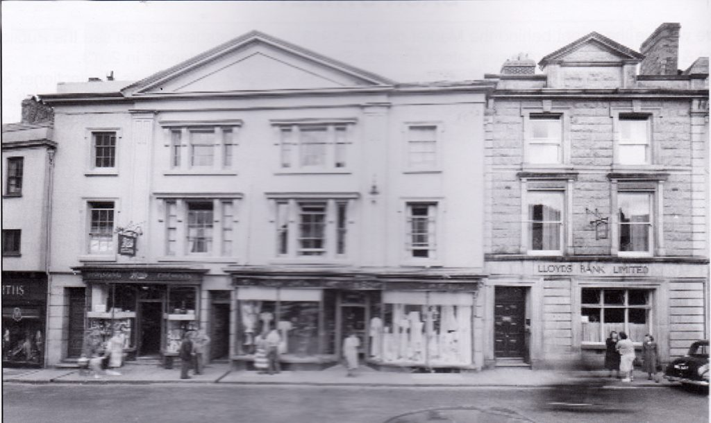 Hicks and Son alongside Lloyds Bank in Broad Street, Launceston in the 1960's.