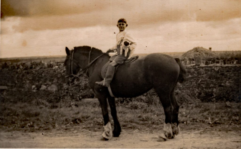 A young Eldred Broad on a farm horse