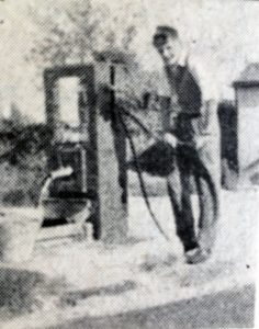 A young man using the pump at South Petherwin.