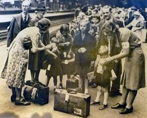 Evacuees gather at a railway station.